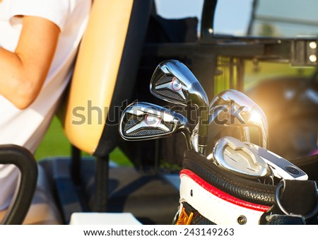 Close up of professional golf gear on the golf course at sunset - stock photo