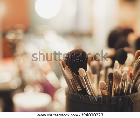 Close up of professional visagist brushes for doing a make up. Fading film colors - stock photo