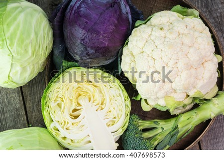 Close up of purple cabbage. cauliflower and green cabbage in a farmers tables. - stock photo