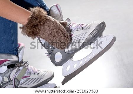 Close-up of putting on ice skates, horizontal - stock photo