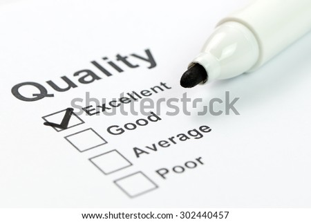 Close up of quality control form and marker - stock photo