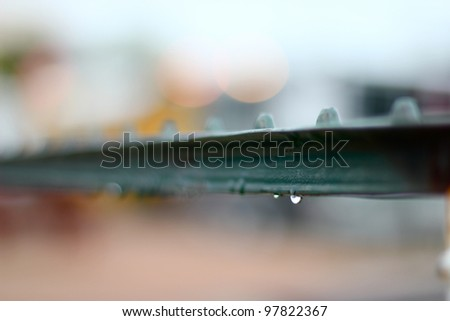 Close up of railing in the rain - stock photo