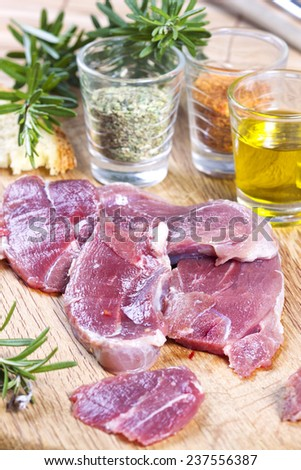 Close-up of raw meat ready to cook - stock photo