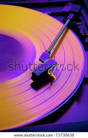 Close up of record player with altered colors shot in studio - stock photo