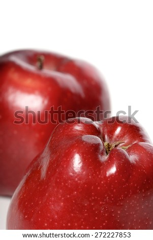 Close-up of red apples on white background - stock photo
