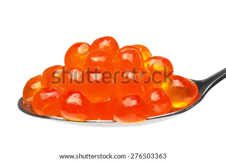 Close-up of red caviar in a teaspoon, isolated on the white background, clipping path included. - stock photo