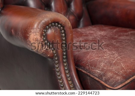 close-up of red chesterfield chair's buttonedarm - stock photo
