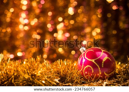 Close up of red christmas ball with golden ornaments on background - stock photo