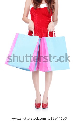 close up of red shopping woman leg and bag isolated on white background - stock photo