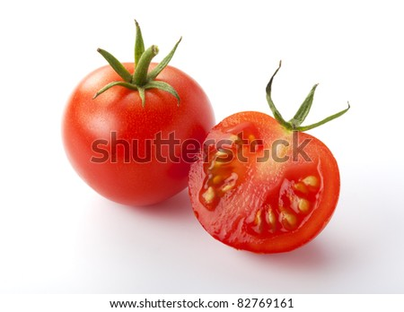 Close up of red small tomatoes isolated over white. - stock photo