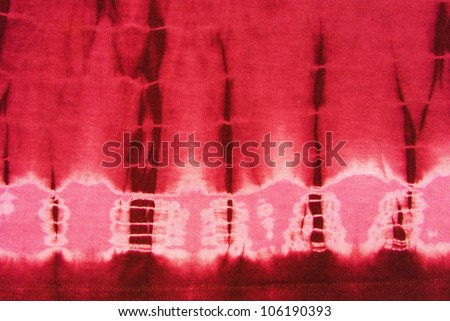 Close up of red tie dye fabric - stock photo