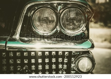 Close-up of retro car facia with chrome grille - stock photo