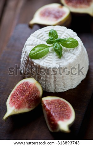 Close-up of ricotta cheese with sliced figs, selective focus - stock photo