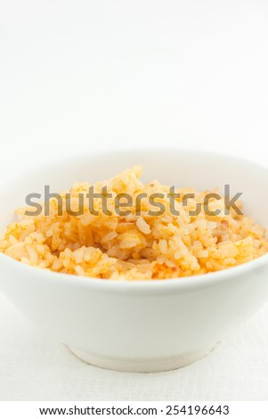 close up of risotto in a white bowl, room for text, shallow depth of field - stock photo