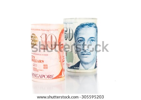 Close up of rolled up Singapore Dollar currency note. - stock photo