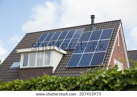 Close up of roof with solar panels - stock photo