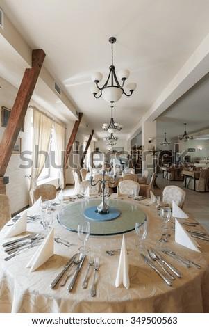 Close-up of round table in elegant restaurant - stock photo