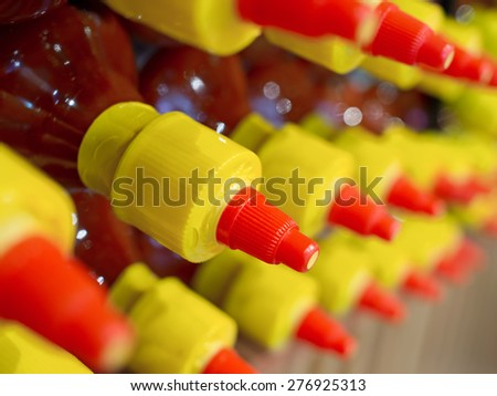 close up of rows of bottled sauce - stock photo
