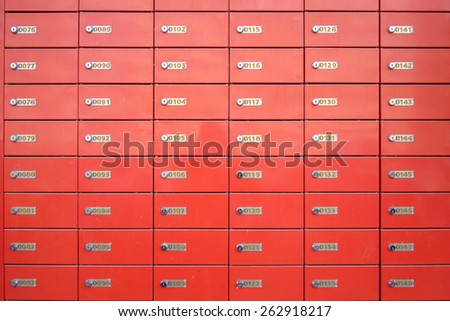 close up of rows of red old mailboxes - stock photo