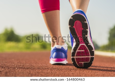 Close up of running shoes in use  - stock photo