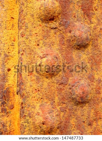 Close up of rusted riveted sheets of metal - stock photo