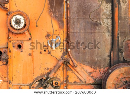 Close-up of rusty cogs and gears of a disused USSR Soviet combine harvester - stock photo