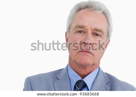 Close up of sad looking mature tradesman against a white background - stock photo