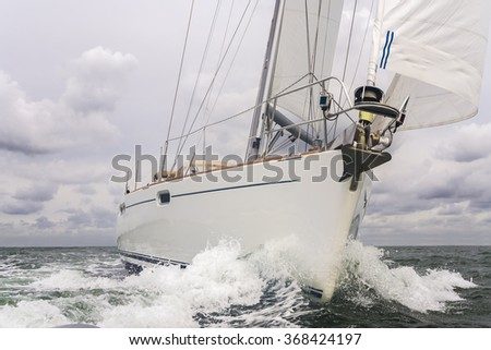 Close up of sailing boat, sail boat or yacht at sea - stock photo