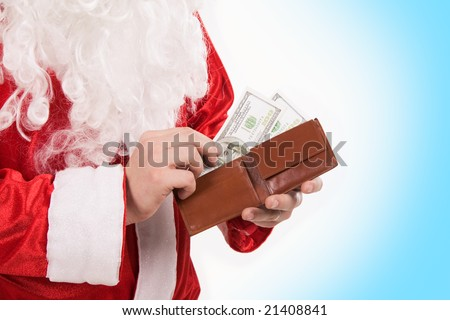 Close-up of Santa?s hands with wallet while counting money - stock photo