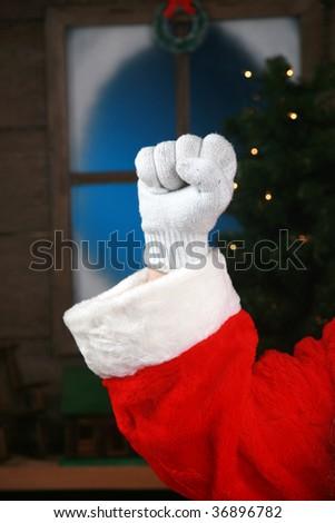 """close up of santas fist giving the """"Santa Power"""" sign - stock photo"""
