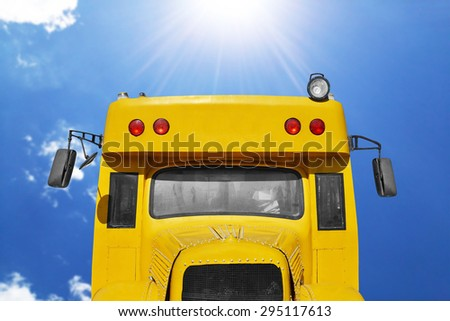 close up of school bus with blue sky - stock photo