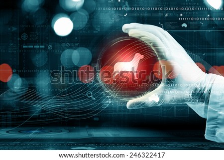 Close up of scientist hand holding glass dish - stock photo