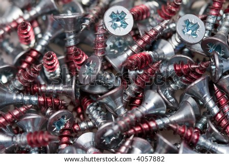 close-up of screws with red tips - stock photo