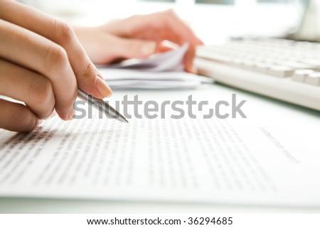 Close-up of secretary?s hands doing paperwork - stock photo