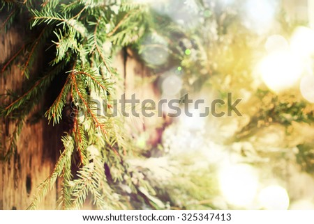 Close up of Selective Focus Natural Wreath with Christmas Light on Wooden Background, warm toned - stock photo