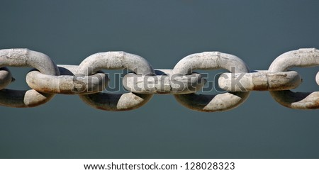 Close-up of several links on an industrial chain - stock photo