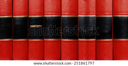 Close up of several volumes of books on bankruptcy - stock photo