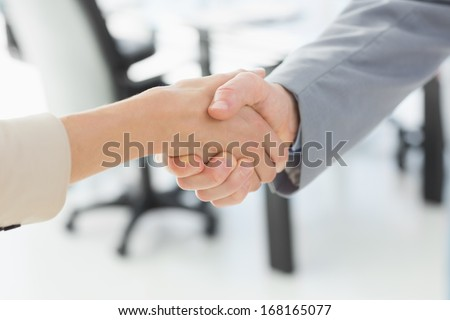 Close-up of shaking hands after a business meeting in the office - stock photo