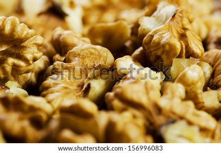 Close-up of shelled walnuts background image. - stock photo