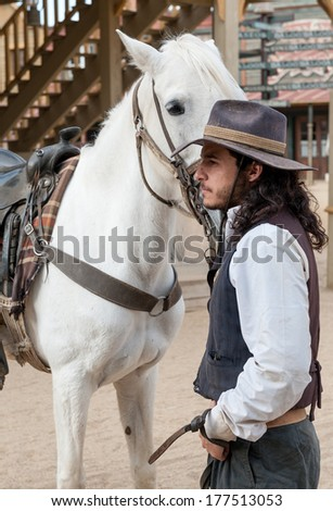 Close up of Sheriff and his horse at Mini Hollywood, Tabernas, Almeria Province, Andalusia, Spain - stock photo