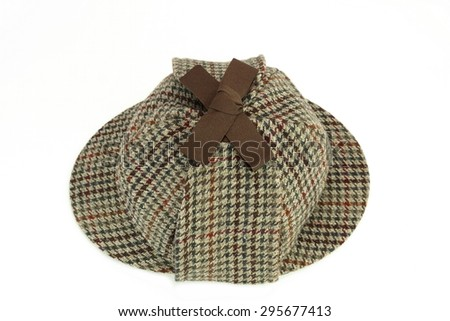 Close-up of Sherlock Holmes Deerstalker Cap Isolated Isolated On White Background. High Angle View - stock photo