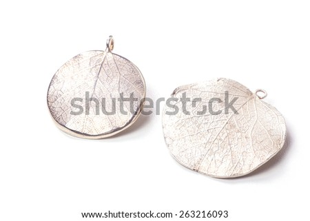Close up of silver earrings isolated on white background manufactured by Ornella Salamone - stock photo
