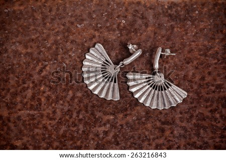 Close up of silver earrings, manufactured by Ornella Salamone - stock photo