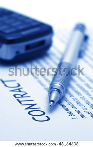 Close-up of silver pen and mobile phone on contract. Selective focus on top of pen. Toned monochrome image. - stock photo