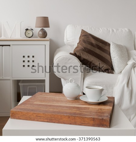 Close up of simple white coffee table - stock photo