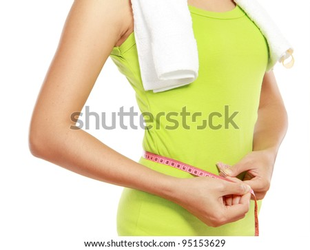 close up of slim female body with measure tape around her body - stock photo