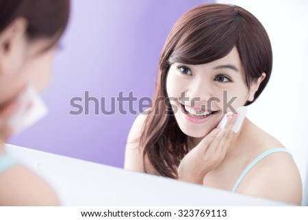 Close up of Smile woman remove makeup by Cleansing Cotton and look mirror. asian beauty - stock photo