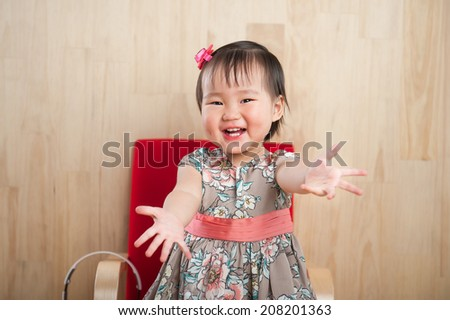 Close up of smiling baby girl - stock photo