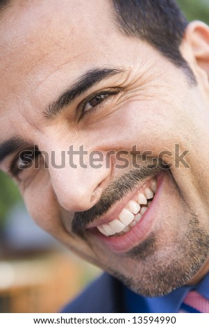 Close-up of smiling businessman looking to camera - stock photo