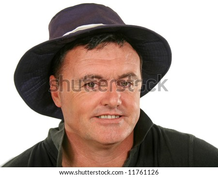 Close up of smiling middle aged man in a hat. - stock photo